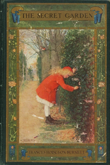 Cover of the 1911 Edition of The Secret Garden by Frances Hodgson Burnett. Shows a girl in a red coat and cap unlocking an ivy covered door. A bare tree is behind her, with a robin sitting on a branch.